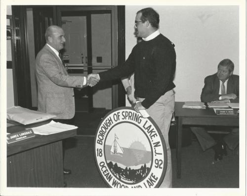 Oberto presenting SL seal from SLPA
